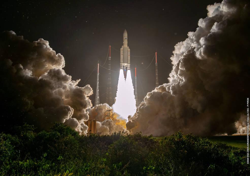 photo:Courtesy of Arianespace;desc:An Arianespace Ariane 5 rocket;