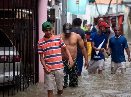 Photo by: Ansa italia; desc: situazione ad Haiti dopo il passaggio di Laura; licence: cc