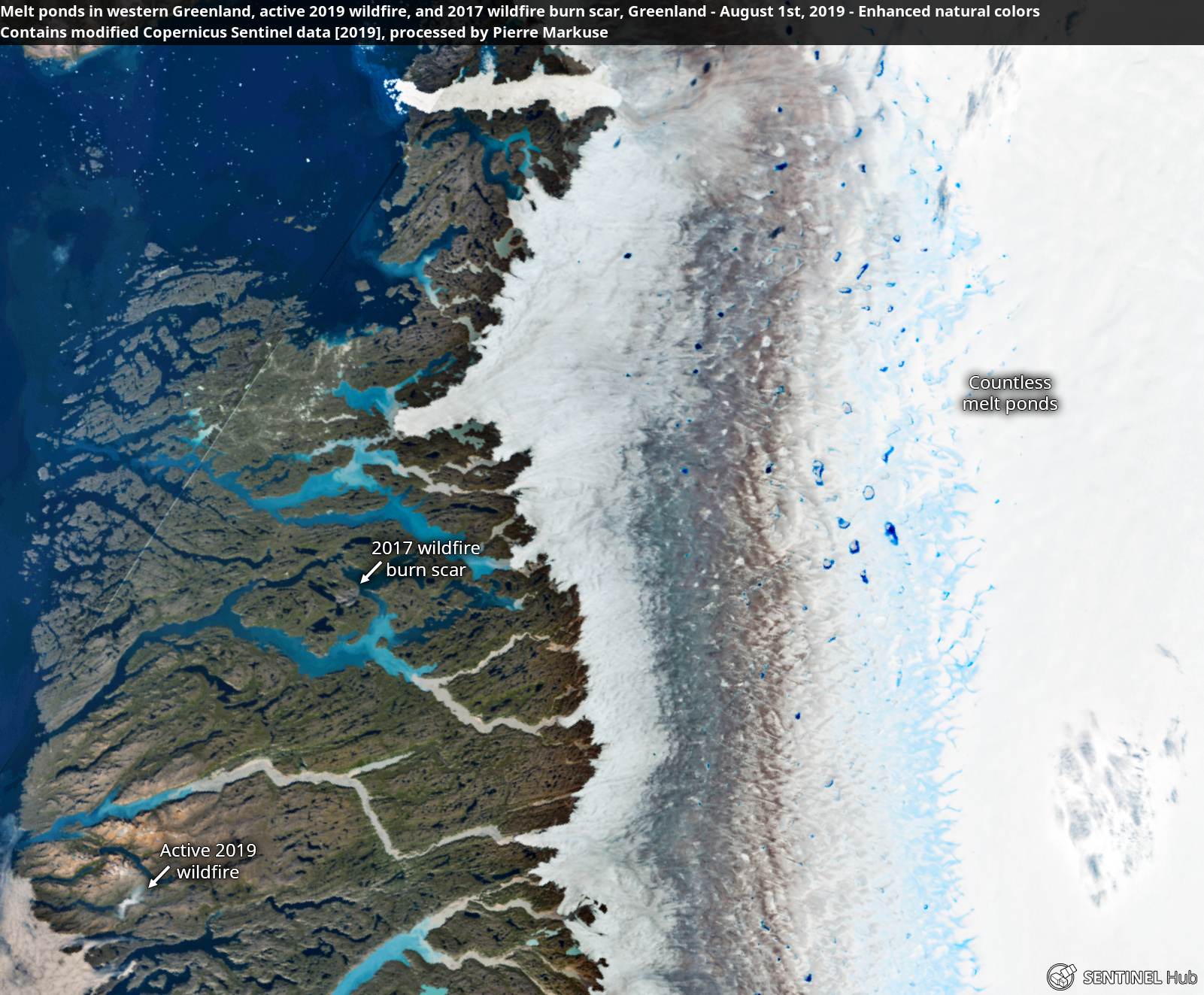 desc:Melt ponds in western Greenland, active 2019 wildfire, and 2017 wildfire burn scar, Greenland - August 1st, 2019 Copernicus/Pierre Markuse