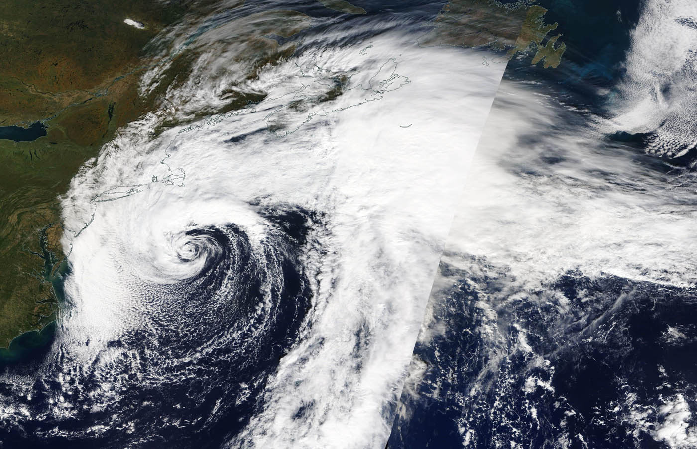 photo:NASA Worldview, Earth Observing System Data and Information System (EOSDIS);desc:On Oct. 11, the MODIS instrument that flies aboard NASA's Terra provided a visible image of Subtropical Storm Melissa off the New England coast.