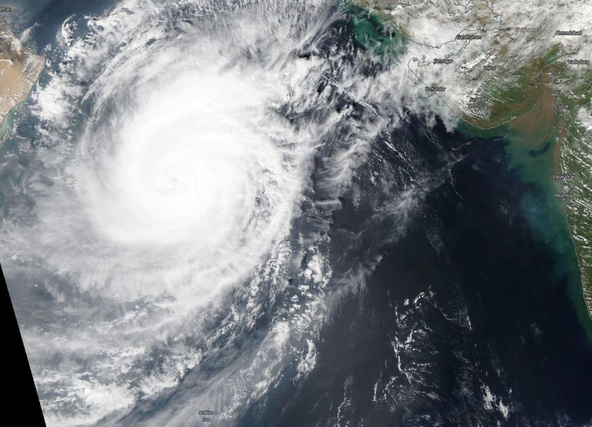 photo: NASA Worldview; desc: On Oct. 30, the MODIS instrument that flies aboard NASA's Terra satellite took this image of Tropical Cyclone Kyarr in the Arabian Sea. The storm maintained an eye, although clouds filled it in.;
