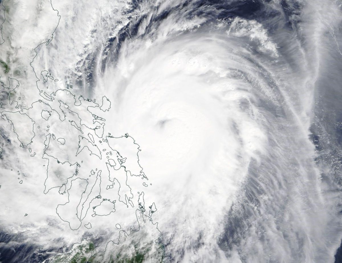 photo:NASA Worldview;desc:On Dec. 2, visible imagery from the MODIS instrument aboard NASA's Terra satellite showed that Kammuri's eye continued to be covered by clouds. The western quadrant of Kammuri was already over the eastern central Philippines.