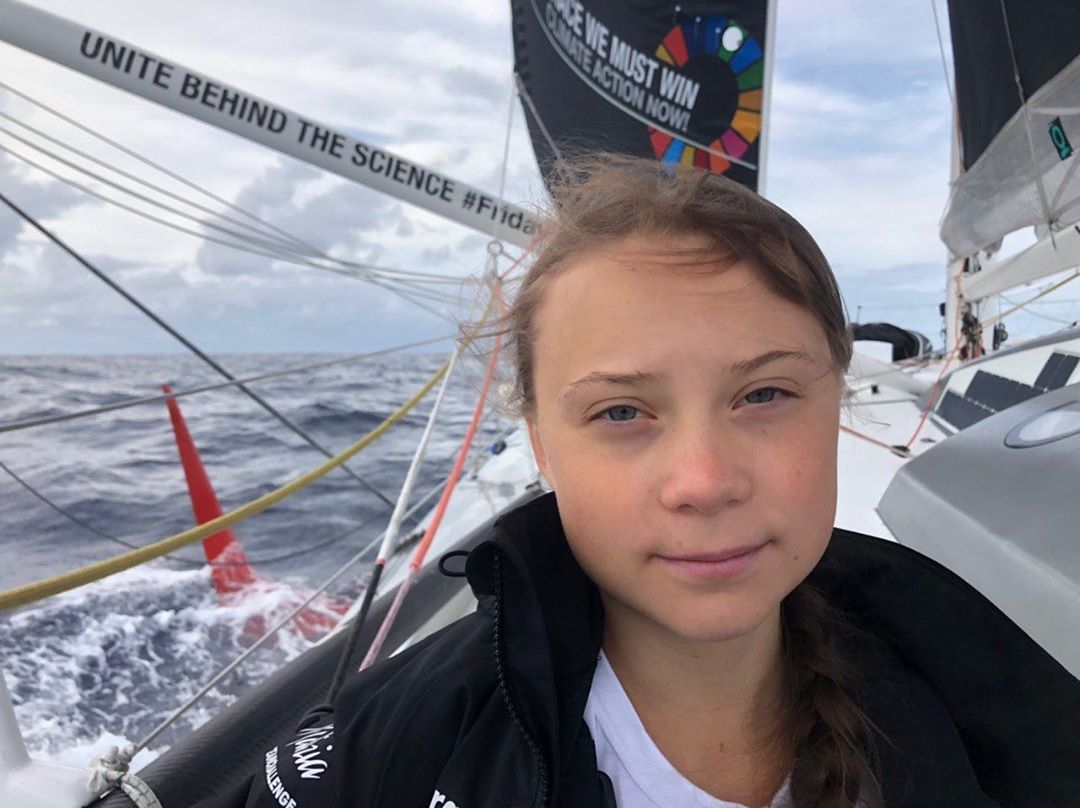 photo:@gretathunberg;desc:A sunny day with nice winds;