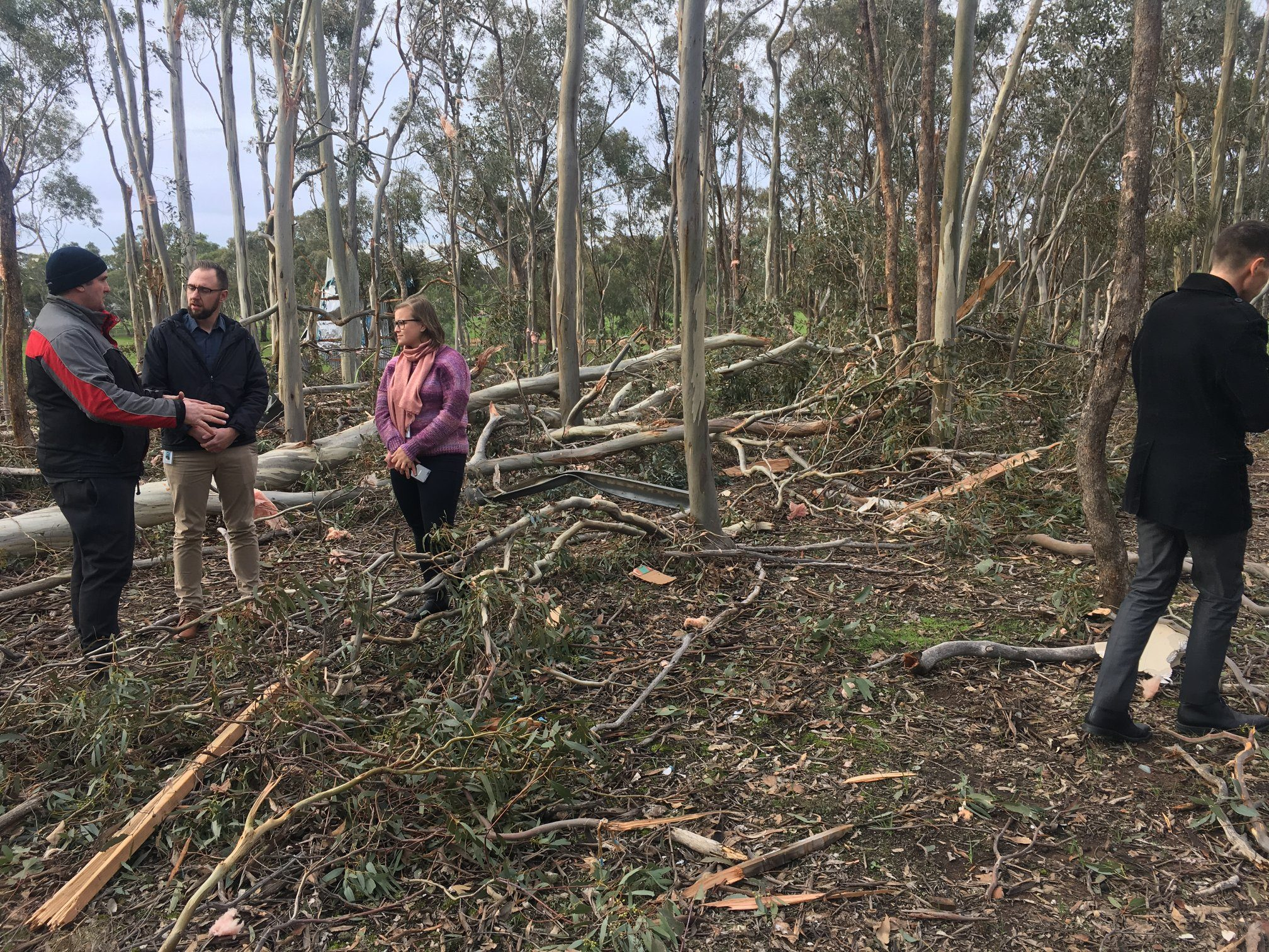 photo: Bureau of Meteorology;link: https://gallery.windy.com/albums/a/tornadoes-in-australia-bom-2019.jpg;desc: Bureau meteorologists meet with owner, Wayne, whose house in Axe Creek, Vic, was destroyed by a tornado on 29 June 2019;